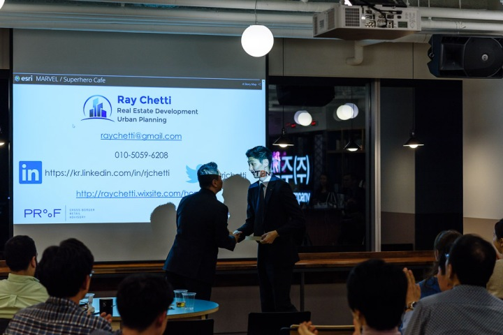 Photograph taken during the corporate event while the speaker was introduced. Photo by Cristian Bucur Photographer in Tokyo Metropolitan Area