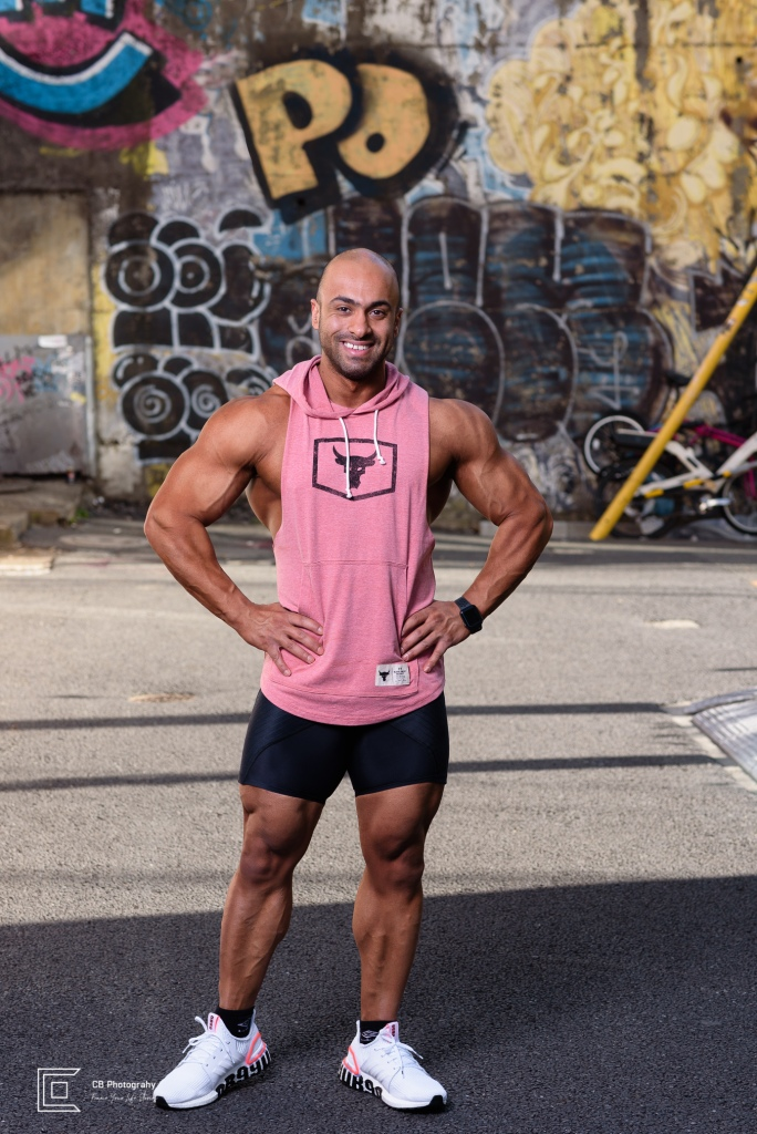 Bodybuilder in shorts smiling during a photoshoot with Cristian Bucur Photographer in Tokyo.