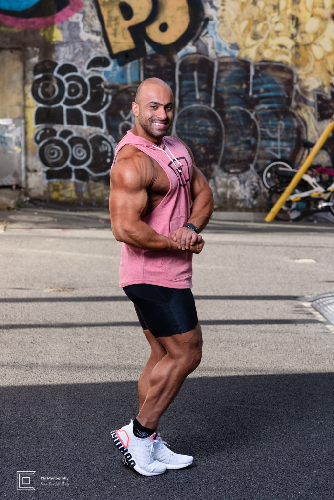 Bodybuilder posing and smiling during a photoshoot with Cristian Bucur Photographer in Tokyo.