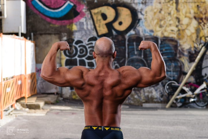 Photograph of the back of a bodybuilder from a photoshoot with Cristian Bucur Photographer in Tokyo.