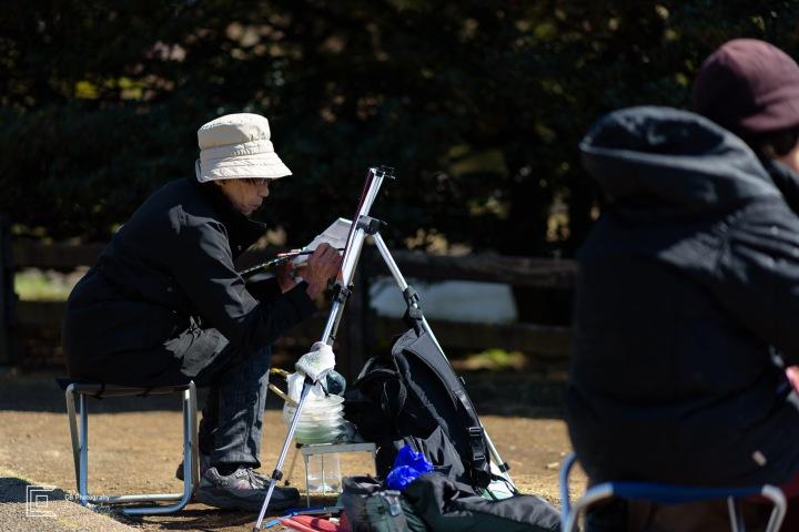Woman painting during Sakura Season