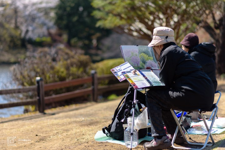 Woman painting during Sakura Season